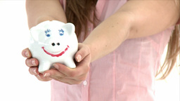 Close up of a teenager holding a piggybank Stock Video Footage
