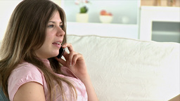 Portrait of a young woman speaking on the phone Stock Video Footage