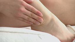 Close up of a woman with ankle pain Stock Video Footage
