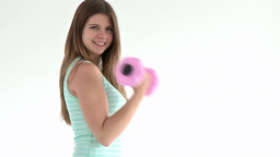 Teenager doing fitness execices holding dumbbells Stock Video Footage