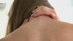 Close up of a woman having a neck pain Footage