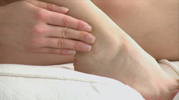 close up of a woman having an ankle pain Stock Video Footage