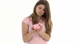 sad student holding a broken piggybank Footage