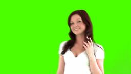 joyful woman against a green screen Stock Video Footage