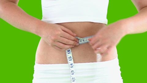 Close up of a woman measuring her waist Footage