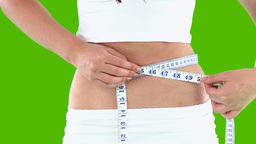 Close up of a woman measuring her waist Stock Video Footage