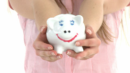 Close up of a woman holding a piggybank Stock Video Footage