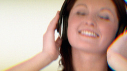 portrait of a smiling woman listening to the music Stock Video Footage