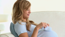 Pregnant caucasian woman lying on a sofa Stock Video Footage