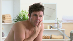 Young man shaving in the bathroom Stock Video Footage
