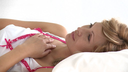 Pensive caucasian woman lying on a bed Footage