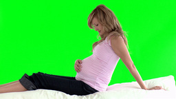 Pregnant woman lying on the floor Footage