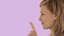 Portrait of a pretty woman doing shh sign Stock Video Footage