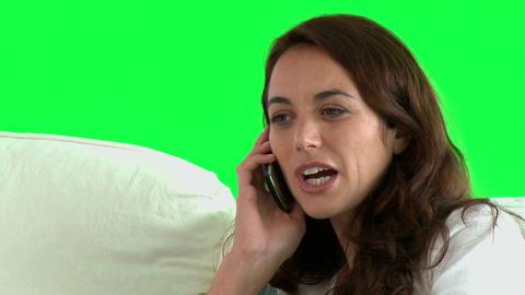 Pretty hispanic woman talking on phone on the sofa Stock Video Footage