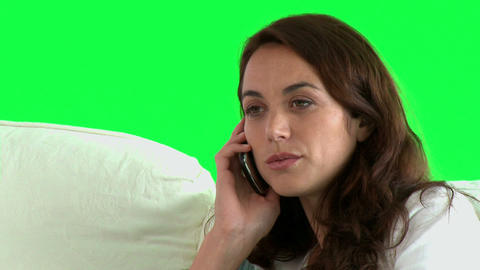 Pretty hispanic woman talking on phone on the sofa Footage