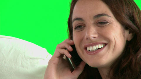 Cheerful hispanic woman talking on phone on the so Footage