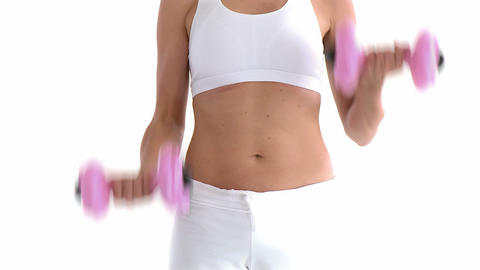 Sporty hispanic woman working out with dumbbells Live Action