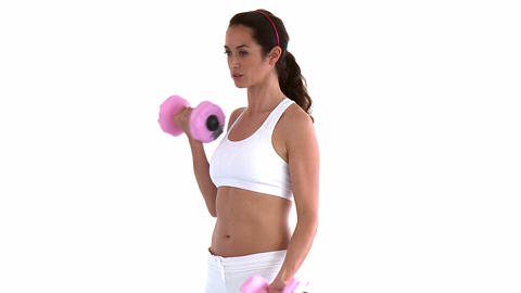 Athletic hispanic woman working out with dumbbells Footage