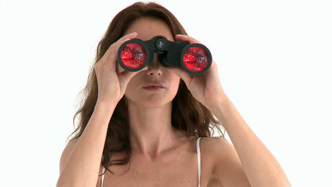 Serious hispanic woman looking through binoculars Stock Video Footage