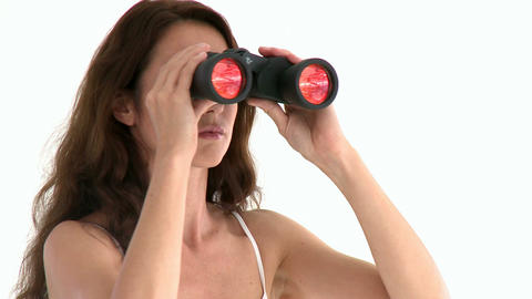 Serious hispanic woman looking through binoculars Footage