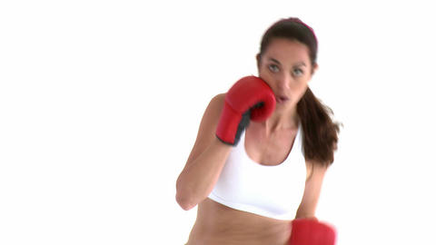 Determined hispanic woman wearing boxing gloves Footage