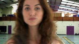 Beautiful woman looking at the camera Footage