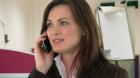 Pretty woman talking on the phone Footage