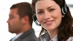 Beautiful woman smiling in an operator team Footage