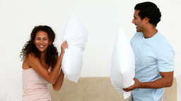 Man and woman having a pillow fight Stock Video Footage