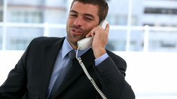 Businessman talking on the phone Footage