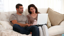 Couple looking at the computer Stock Video Footage