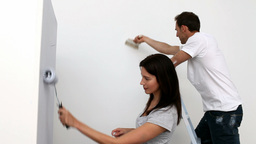 Couple painting wall Stock Video Footage