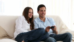 Man playing video games with his girlfriend Footage