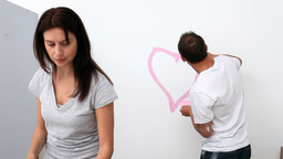 Man drawing a heart on the wall Stock Video Footage