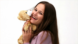 Beautiful Woman Playing With A Teddy Bear stock footage