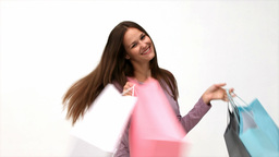 Happy woman returning home from shopping Stock Video Footage