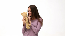 Happy Woman Playing With A Teddy Bear stock footage