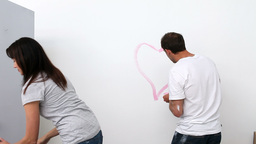 Husband drawing a heart on the wall Footage