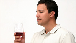 Happy man drinking red wine Footage