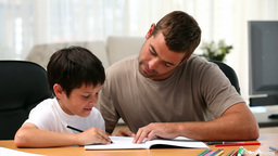 Father and son doing homework Stock Video Footage