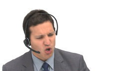 Angry businessman on the phone with earpiece Footage