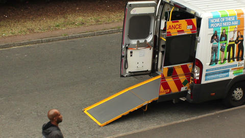 Ambulance with open doors and extended ramp. Black Footage