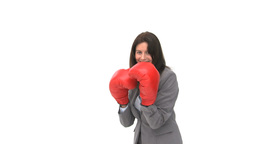 Happy businesswoman with boxing gloves Stock Video Footage