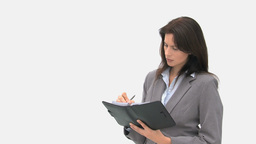 Serious businesswoman writing on her agenda Stock Video Footage
