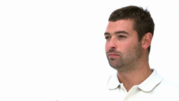 Thoughtful man eating an apple Stock Video Footage