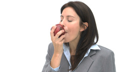 Woman eating an apple Stock Video Footage