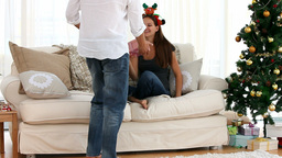 Woman offering a present to her husband Footage