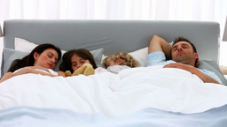 Lovely family sleeping together Footage