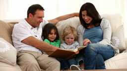 Cute family reading a book Stock Video Footage
