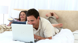 Joyfully couple laughing lying on the bed Stock Video Footage